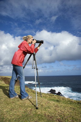Woman photographing scenery.