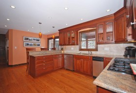 Renovated Kitchen with cherry cabinets, granite countertops, stainless appliances and gorgeous hardwood floors